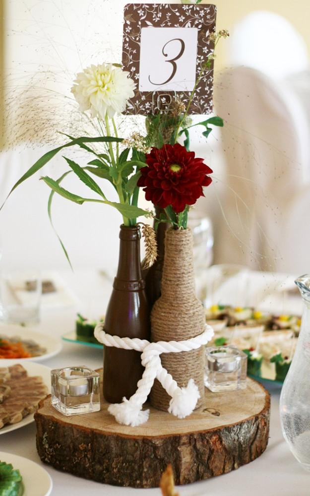 Vestuvių floristika - gėlės buteliuose