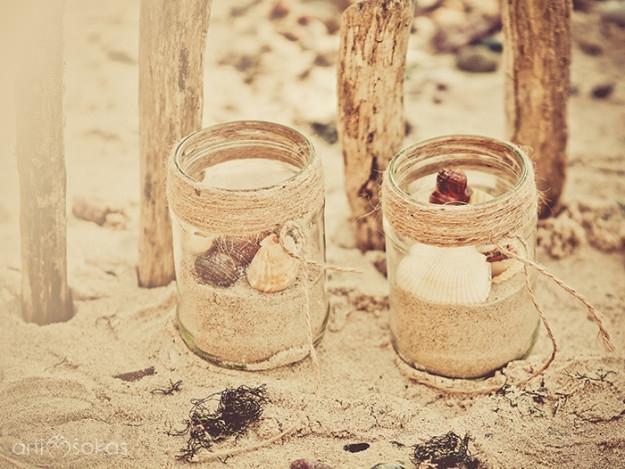 Stiklainėliai su smėliu ir kriauklėmis